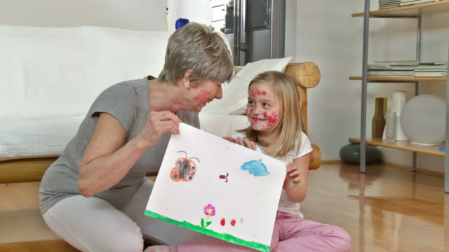 HD DOLLY: Funny Granny And Little Girl With Smeared Faces