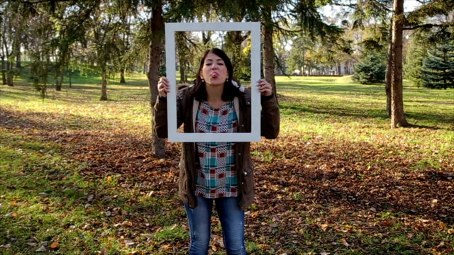 funny grimacing on photography on picture frame - cinemanis videography stock videos & royalty-free footage