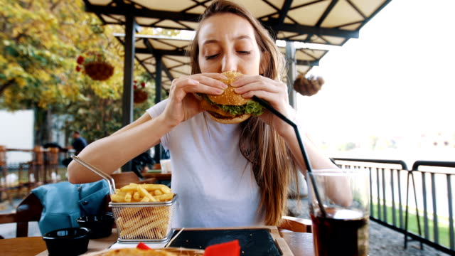 funny hungry woman biting her burger - hamburger stock videos and b-roll footage