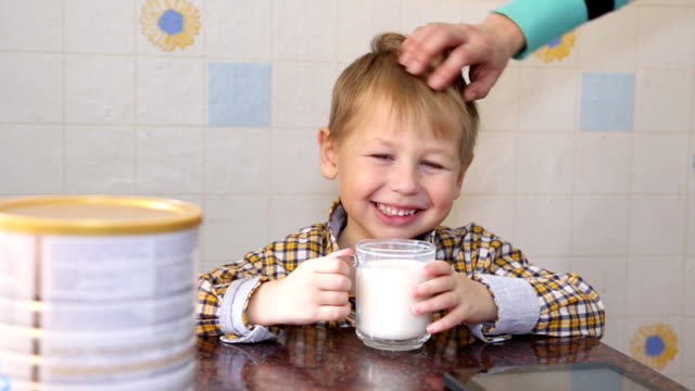 funny kid happy to drink powdered milk - powdered milk stock videos & royalty-free footage