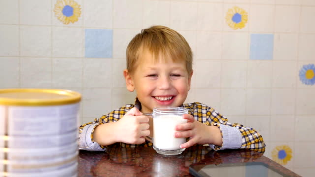 funny kid happy to drink powdered milk - toddler stock videos & royalty-free footage