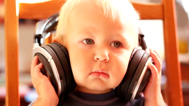 funny kid with headphones - one baby boy only stock videos & royalty-free footage
