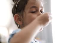 Funny Little Girl Eating A Cake