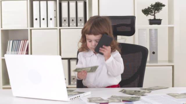 hd: funny little girl in office - adult imitation stock videos & royalty-free footage