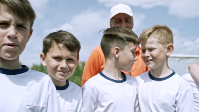funny little soccer players posing at camera - grimacing stock videos and b-roll footage