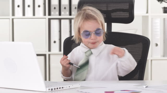hd: funny little yuppie boy in office - adult imitation stock videos & royalty-free footage