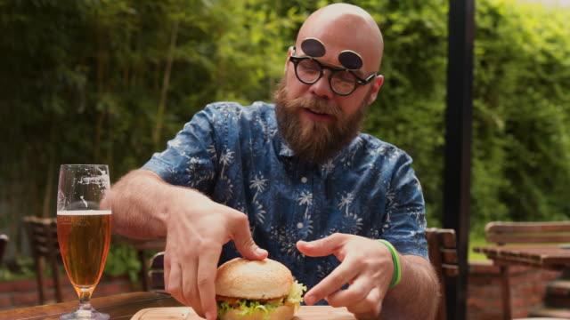 funny man enjoying his burger - eating stock videos & royalty-free footage
