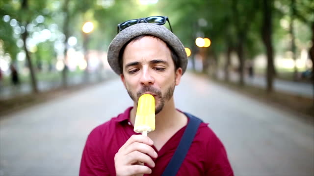 funny man licking ice cream - licking stock videos & royalty-free footage