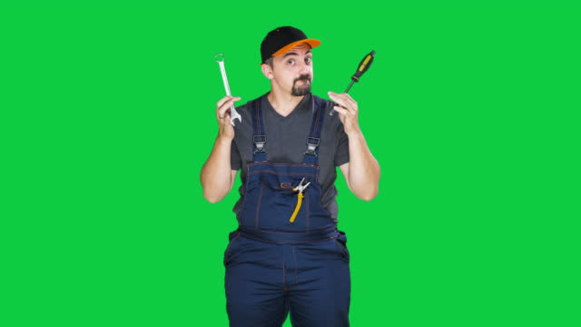 funny mechanic with wrench on green background, slow motion - manual worker stock videos & royalty-free footage