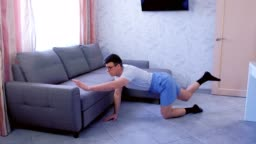 Funny nerd man is doing balance pose on all fours at home and falling. Sport humor concept.