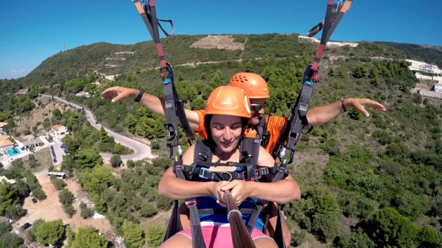funny paragliding instructor - paragliding stock videos & royalty-free footage