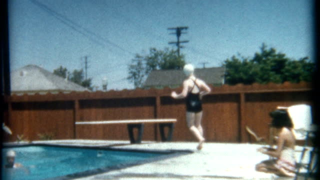 funny pool dive 1952 - swimming cap stock videos and b-roll footage