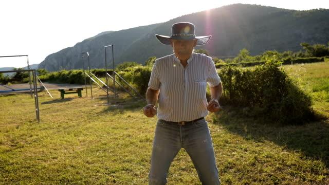 funny senior man imitates a cowboy - eccentric stock videos & royalty-free footage