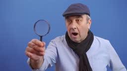 Funny Senior Old Man using Magnifying Glass.