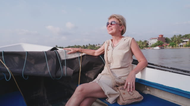 funny tropical vacations. mature 55-years-old caucasian white woman riding a motorboat. - 55 59 years stock videos & royalty-free footage
