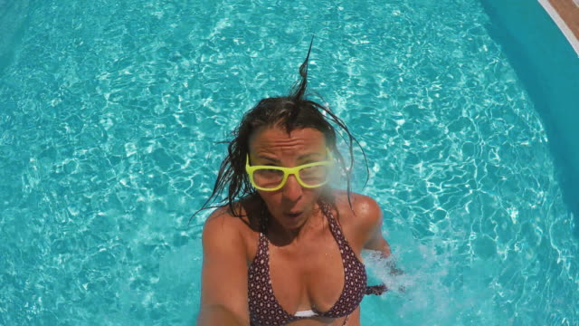 funny woman falling in swimming pool - back to front stock videos and b-roll footage