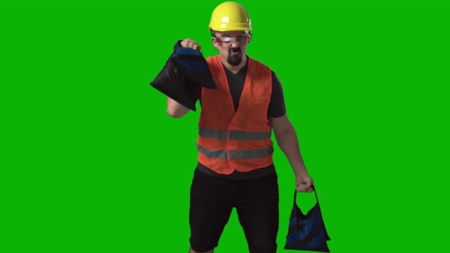 funny worker, engineer or architect lifting weights chroma green screen background - weight training stock videos & royalty-free footage