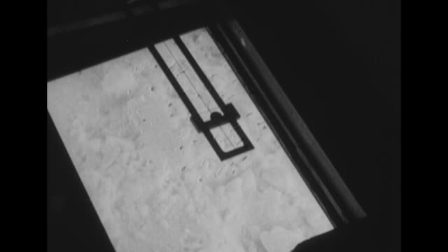 furmittened hand opens sliding door on bottom of the josephine ford fokker airplane displays and adjusts the drift indicator instrument beneath which... - mitten stock videos and b-roll footage