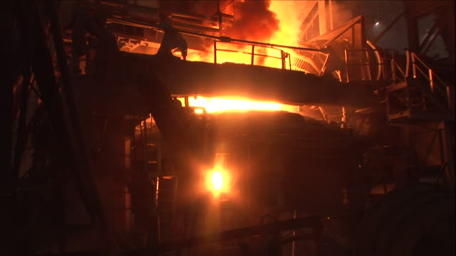 a furnace heats steel in a steel mill. - power equipment stock videos & royalty-free footage