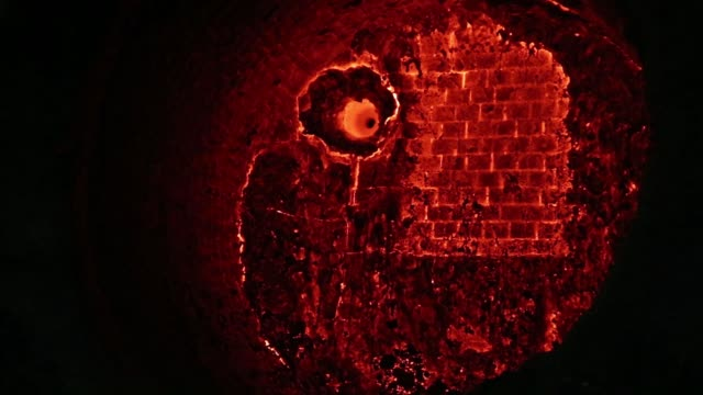 Furnace lining bricks glow red hot in a furnace at the ArcelorMittal steel plant in Zenica Bosnia on Thursday March 17 Long lengths of red hot steel...