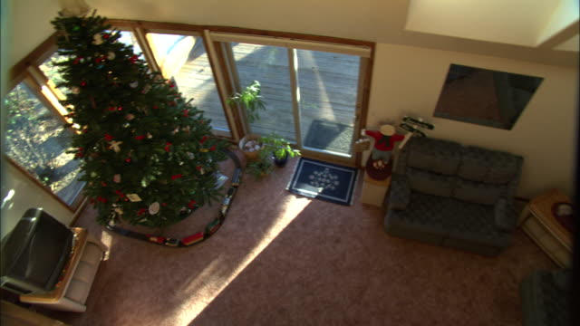 furniture and a christmas tree fill a pyramid house. - loft apartment stock videos & royalty-free footage