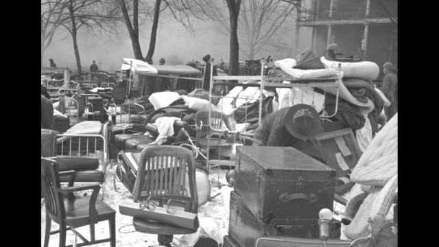 vs furniture and belongings evacuated from burning barracks army soldier holds up a coat folds it over his arm looks through the items / firefighters... - fort myer stock videos and b-roll footage