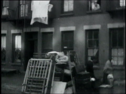 furniture and belongings piled in front of building after eviction / usa - great depression stock videos & royalty-free footage