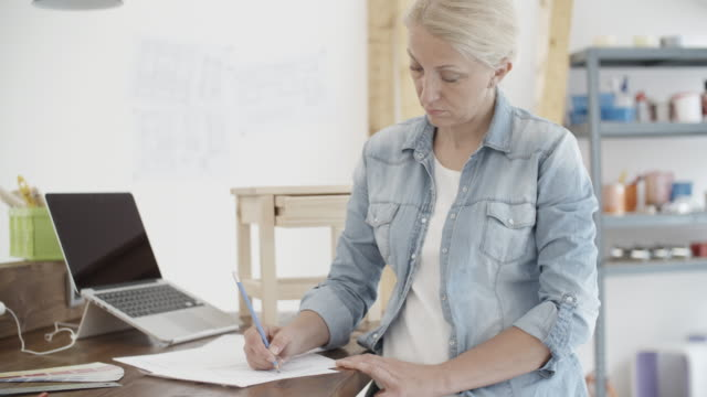 4K: Furniture Designer Working On New Project In Her Workshop.