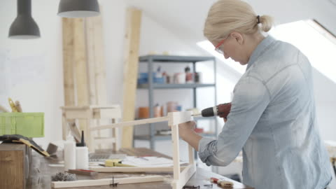 4k: furniture designer working on new project in her workshop. - cordless phone stock videos & royalty-free footage