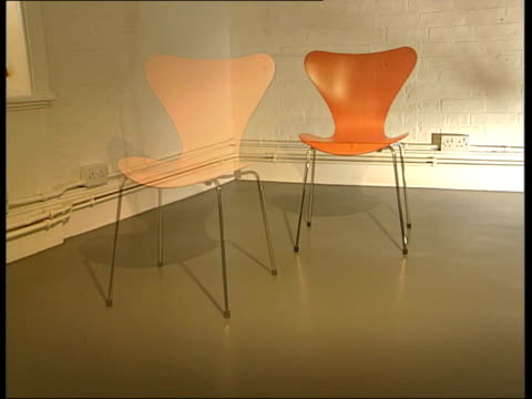 furniture designers call for copyright protection england london ***music overlaid sequence arne jacobson coloured chair montage in gallery - chair stock videos & royalty-free footage