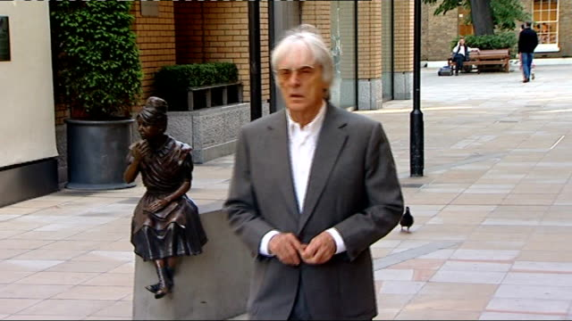 further clashes between police and anti-government protestors; t07061123 london: ext bernie ecclestone along - bernie ecclestone stock videos & royalty-free footage