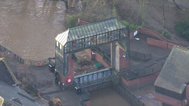 further flooding threatened as government flood defence spending attacked; england: yorkshire: york: ext air view / aerial foss barrier, flood... - river ouse stock videos & royalty-free footage