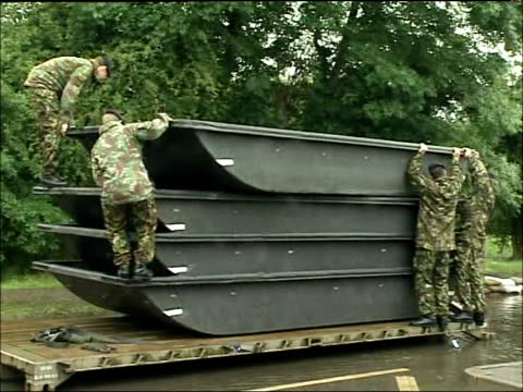 further heavy rain and flood warnings toll bar british army soldiers lift small plastic boats from truck - itv weekend evening news点の映像素材/bロール