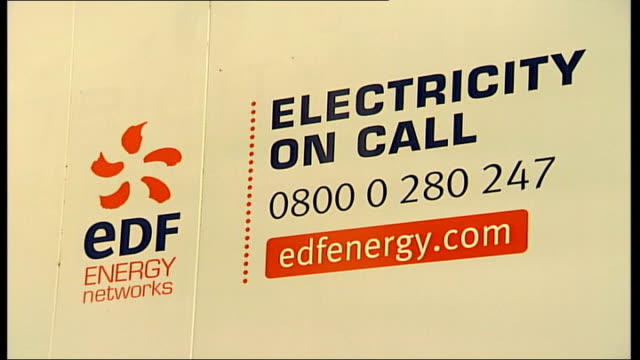 GVs Shops and restaurants in darkness in Carnaby Street/Regent Street EDF energy sticker on side of van PAN as driver gets out PULL ZOOM to word...