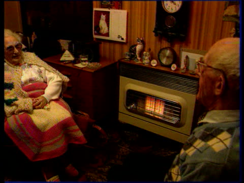 Further snow prompts calls for restructure of government cold weather payments TX 271295 Old lady with blanket over knees sitting by fire FREEZE