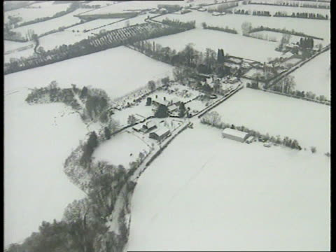 Further snow prompts calls for restructure of government cold weather payments ENGLAND Kent over snowcovered Kent countryside including castle EC4...