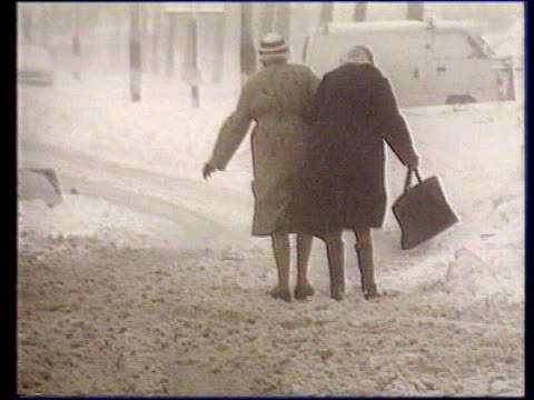 Further snow prompts calls for restructure of government cold weather payments TX Two old ladies gingerly along snowcovered street ** Chalmers...