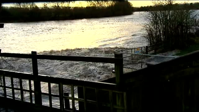 further storms and flooding hit uk england gloucestershire ext tidal wave / water surge along swollen river severn tidal wave on river severn... - gloucestershire stock videos and b-roll footage