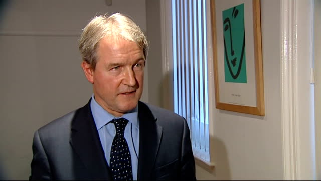 further storms and flooding hit uk london owen paterson mp from car and into building owen paterson interview sot reporter to camera - オーウェン・パターソン点の映像素材/bロール