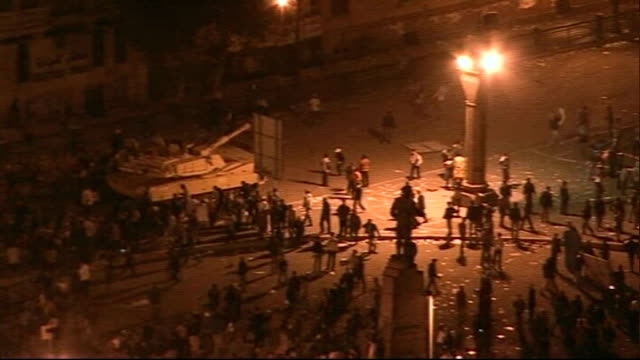 Further violent clashes between rival protesters EGYPT Cairo Various high angle views of Mubarak supporters throwing stones at retreating military...