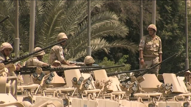 further violent clashes following the removal of mohamed morsi as president; egyptian army soldiers manning armoured vehicles bayonet fixed to rifle - bayonet stock videos & royalty-free footage