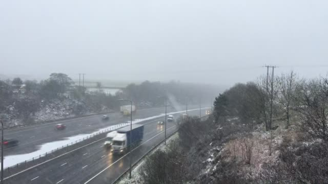 further winter storms cause travel disruption northern england close shot of snow and slush on road as van passes van slipping as attempting to drive... - slush stock videos and b-roll footage