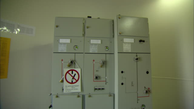 ws fuse box inside wind turbine with warning sign against blade breaking / paderburne, germany - fuse box stock videos and b-roll footage