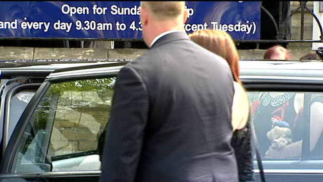 funeral held greater manchester bury lyn rigby out of car on arrival at funeral gv mass mourners behind barrier bv mourners hugging one another - lee rigby stock videos & royalty-free footage