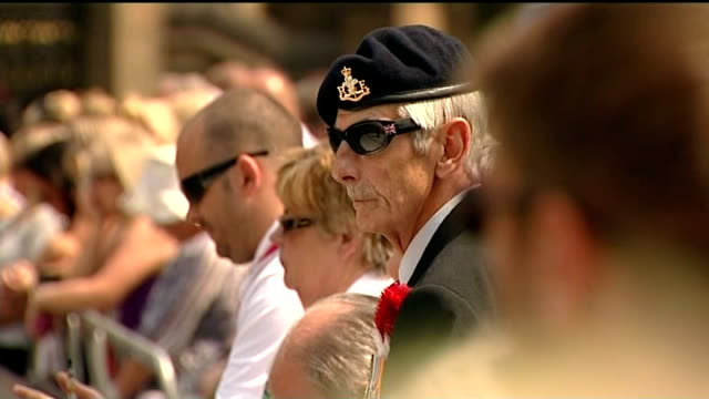 funeral held hearse carrying lee rigby coffin along past applauding spectators lining road as it leaves church following funeral service - carro funebre video stock e b–roll