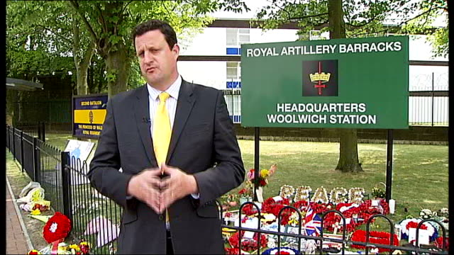 funeral held london woolwich royal artillery barracks ext reporter to camera close shots of wreaths on ground close shot message to - ウールウィッチ点の映像素材/bロール