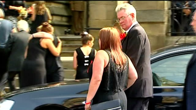 funeral held lyn rigby and ian rigby from car outside church back view of rigby family up steps to church lyn rigby and ian rigby towards church... - lee rigby stock videos & royalty-free footage