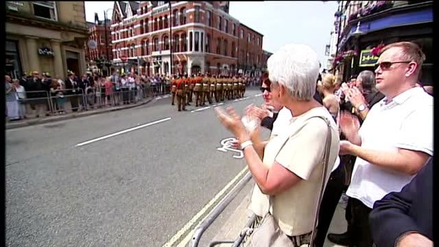 funeral held soldiers marching along the street as crowd applaud reporter talking with members of the royal air force cadets vox pops raf cadet sot... - carro funebre video stock e b–roll