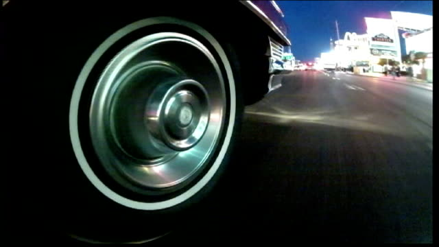 Future of cars USA Nevada Las Vegas EXT/DAWN Low angle shot of classic car along past fire hydrant as radio music overlaid SOT Mike Nicholl and ITN...