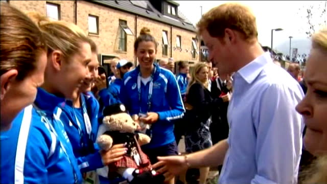future of the commonwealth; harry talking to female scottish athletes holding teddy bear dressed in kilt mascot harry and william and kate talking to... - sportlerin stock-videos und b-roll-filmmaterial